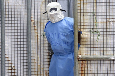 A health worker in protective suit stands at Island Hospital in Monrovia. Liberia, October 2, 2014. (Farrus/Flickr)