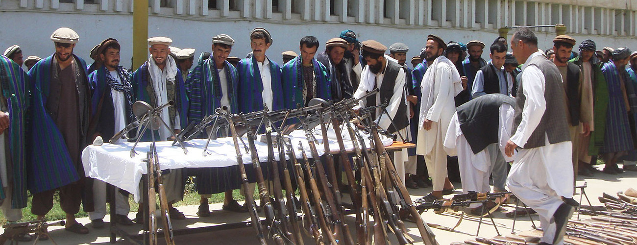Taliban fighters attend a surrender ceremony in Baghlan province, north Afghanistan, on July 14, 2014. (Sahil/Xinhua Press/Corbis)