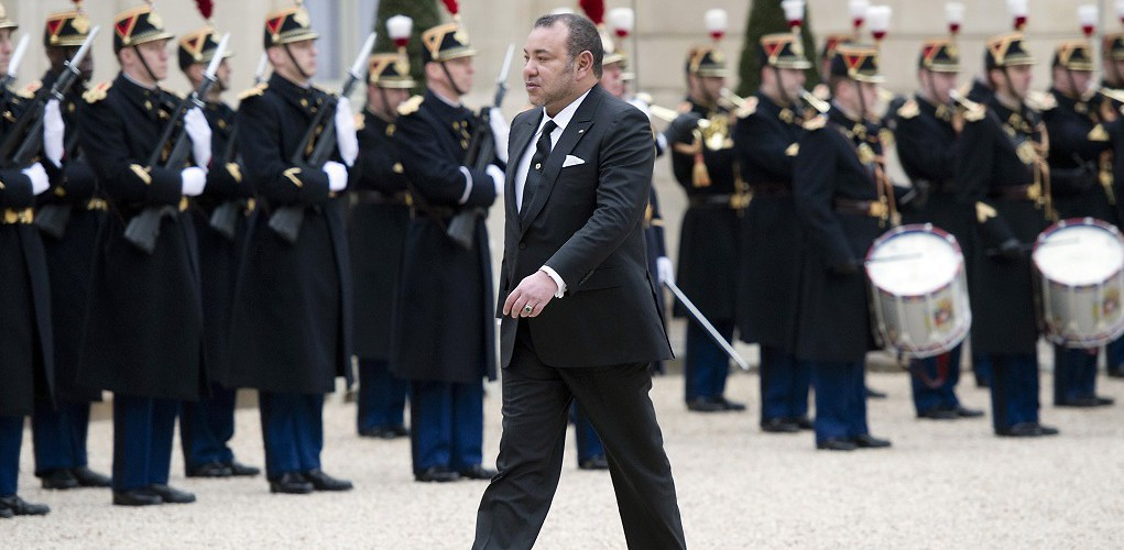 Moroccan King Mohammed VI passes Republican Guards as he prepares to meet French President Francois Hollande. Paris, France, February 9, 2015. (Alain Jocard/AFP/Getty Images)