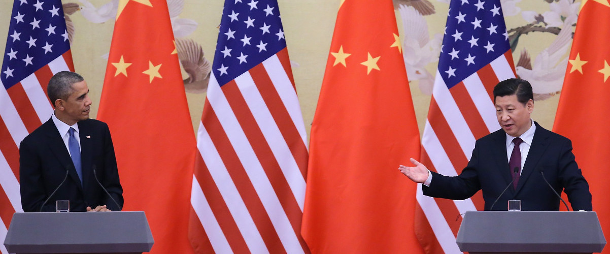 US President Barack Obama and Chinese President Xi Jinping speak after an Asia-Pacific Economic Cooperation meeting. November 12, 2014, Beijing, China. (Feng Li/Getty Images)