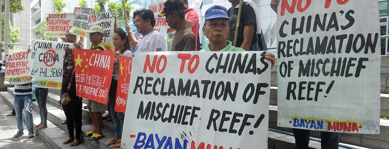Protesters demonstrate outside Chinese consular offices against South China Sea land reclamation. Manila, the Philippines, April 17, 2015. (Jay Directo/AFP/Getty Images)