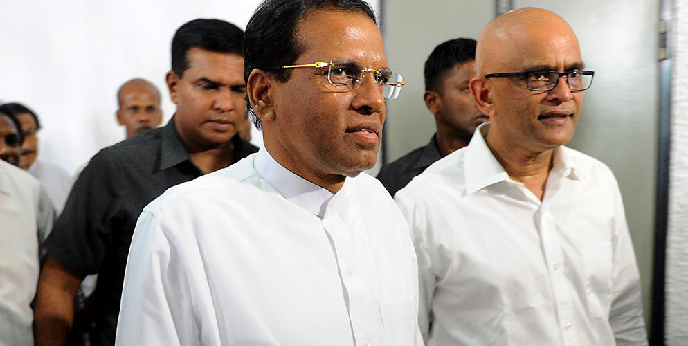 Sri Lanka's President Maithripala Sirisena emerges from a meeting naming him leader of the New Democratic Front party. Colombo, Sri Lanka, January 16, 2015. (Ishara S. Kodikara/AFP/Getty Images)