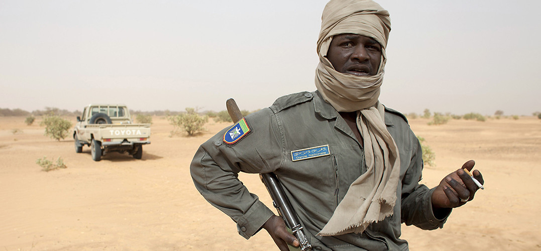A member of Mauritania's National Guard on patrol in 2012, following the growth of al-Qaeda in the Islamic Maghreb in nearby northern Mali. Bassikounou, Mauritania, May 22, 2012. (Joe Penney/Reuters/Corbis)