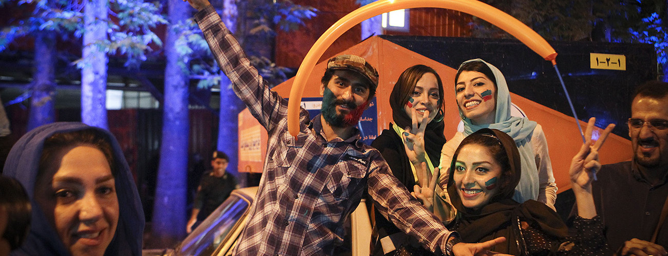 Young Iranians celebrate the agreement between their government and six world powers, which curbed the country's nuclear program in exchange for sanctions relief.  Tehran, Iran, July 15, 2015. (Ahmad Halabisaz/Xinhua/Corbis)