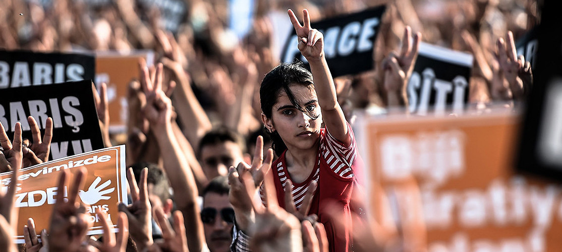 Protesters call for peace, following Turkish airstrikes that killed hundreds of members of the Kurdistan Workers' Party, as part of a campaign supposedly targeting the so-called Islamic State. Istanbul, Turkey, August 9, 2015. (Ozan Kose/AFP/Getty Images)
