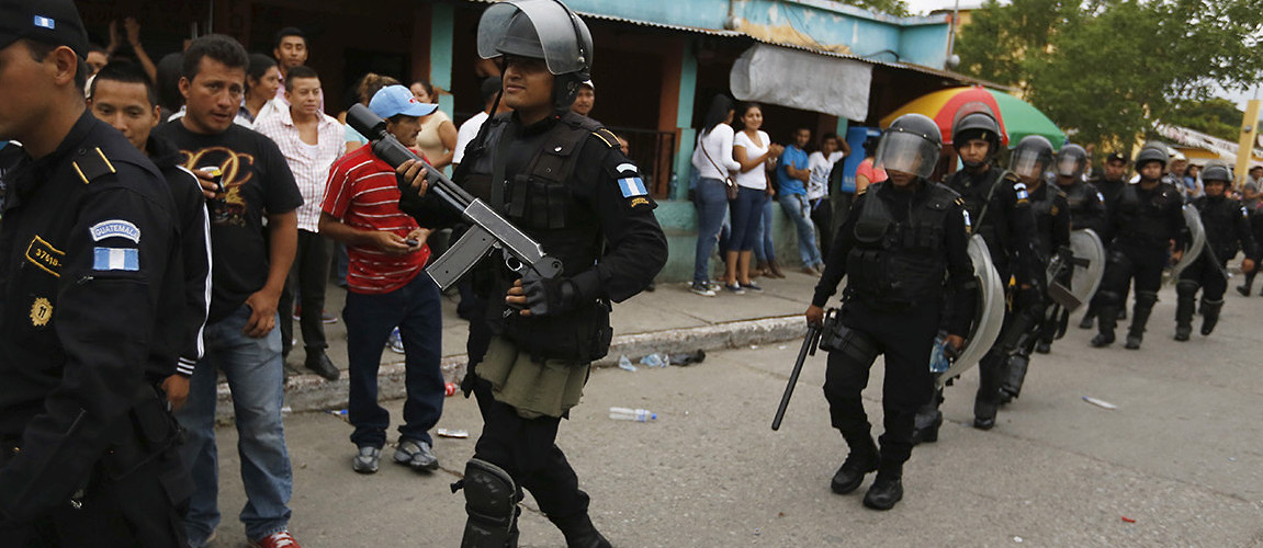 Police officers patrol the perimeter of a polling station during the recent Guatemalan general election. Guatemala City, Guatemala, September 6, 2015. (Jorge Dan Lopez/Corbis/Reuters)