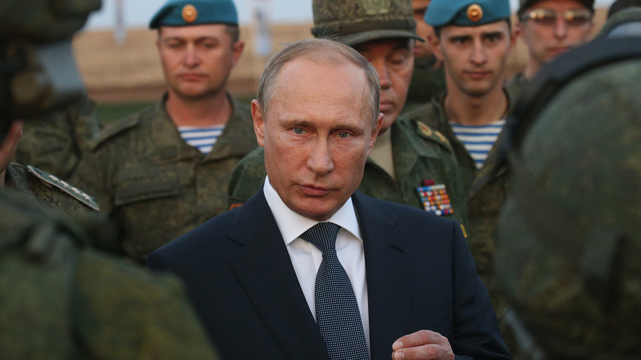 Russian President Vladimir Putin talks to officers during a visit to the Center -2015 Military Drills at Donguzsky Range in Orenburg, Russia, September,19,2015. (Sasha Mordovets/Getty Images)