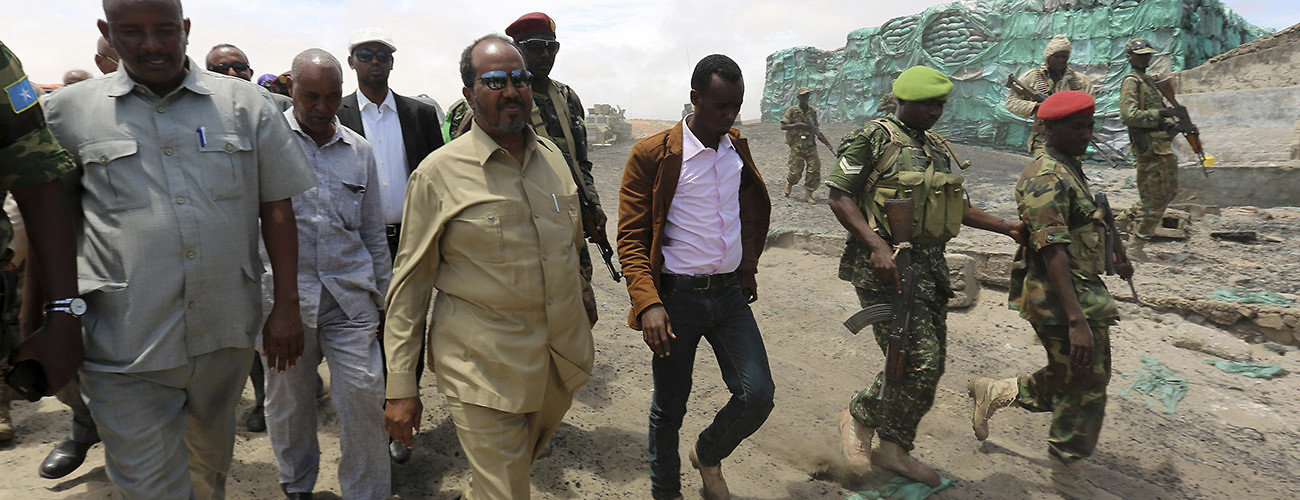 Somalian President Hassan Sheikh Mohamud (C) visits an area recaptured from Al-Shabaab extremists. Barawe, Somalia, October 12, 2014. (Feisal Omar/Reuters/Corbis)