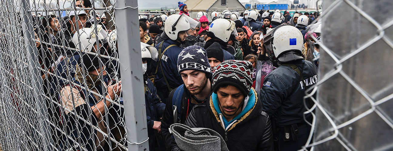 Migrants and refugees wait to cross the border from Macedonia to Greece. Gevgelija, Macedonia, December 4, 2015. (Armend Nimani/AFP/Getty Images)