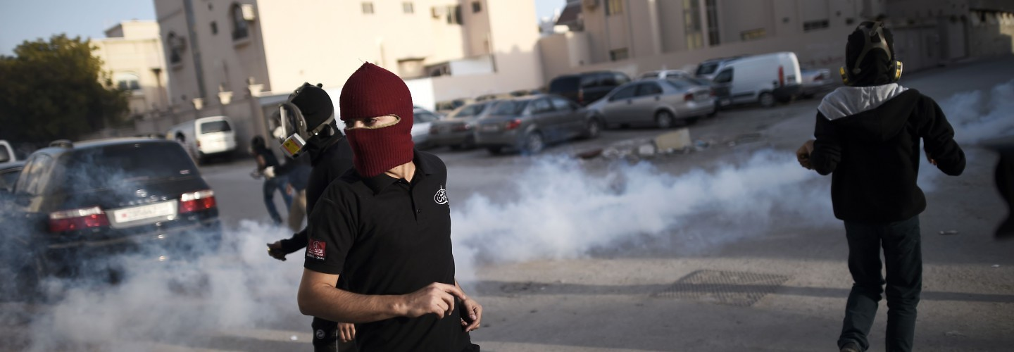Protesters angered at the Saudi execution of Shiite cleric Nimr al-Nimr run for cover during clashes with riot police. Sitra, Bahrain, January 8, 2016.(Mohammed Al-Shaikh/AFP/Getty Images)