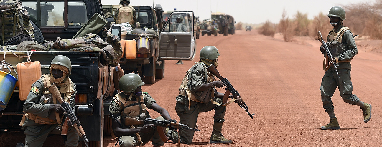 Malian soldiers secure an area between the towns of Goundam and Timbuktu. Northern Mali, June 2, 2015. (Philippe Desmazes/AFP/Getty Images)