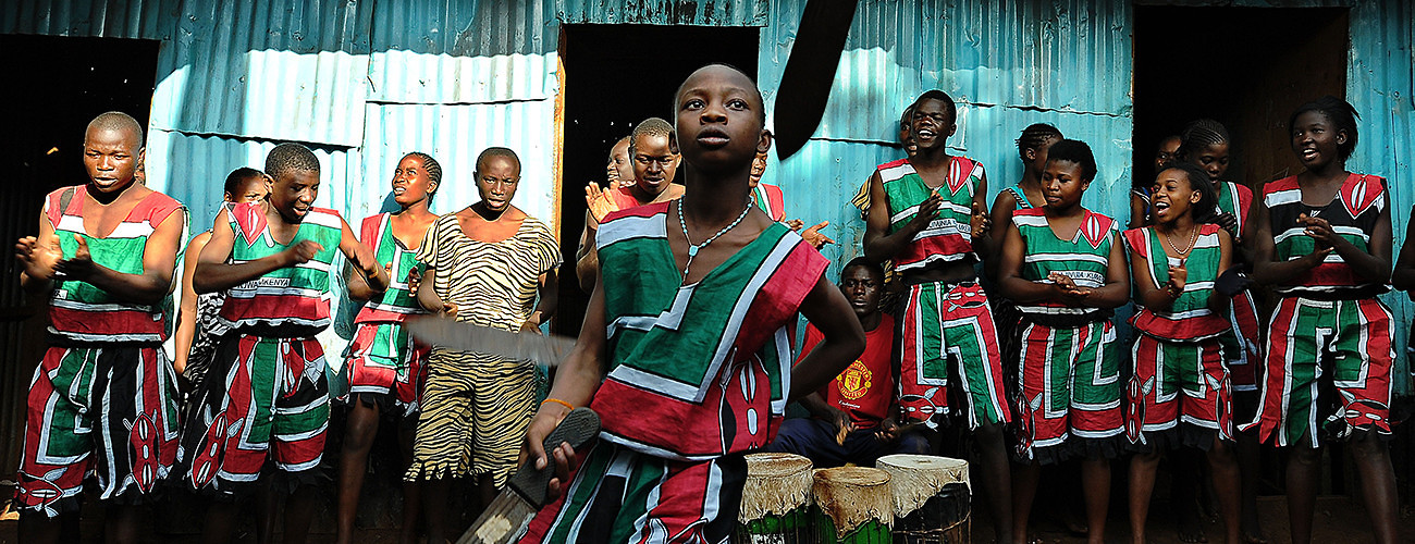 Members of a pro-peace youth group perform in Nairobi's Kibera slum following a recurrence of violent rhetoric within the community. Nairobi, Kenya, July 28, 2014. (Tony Karumba/AFP/Getty Images)