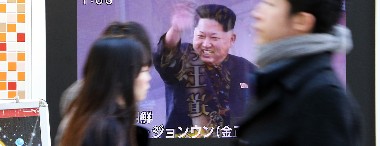 Pedestrians pass a television displaying a report of North Korean leader Kim Jong-un and the recent missile launch. Tokyo, Japan, February 7, 2016. (Yoshikazu Tsuno/AFP/Getty Images)