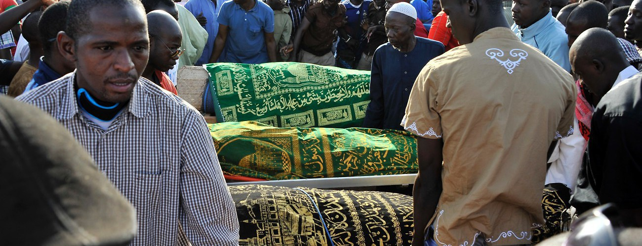 The bodies of five of the victims of the November 2015 attack during their funeral in Bamako. Gunmen had gone on a shooting rampage at the luxury Radisson hotel in Mali's capital, seizing 170 guests and staff. Bamako, Mali, November 25, 2015. (AFP/Getty Images)