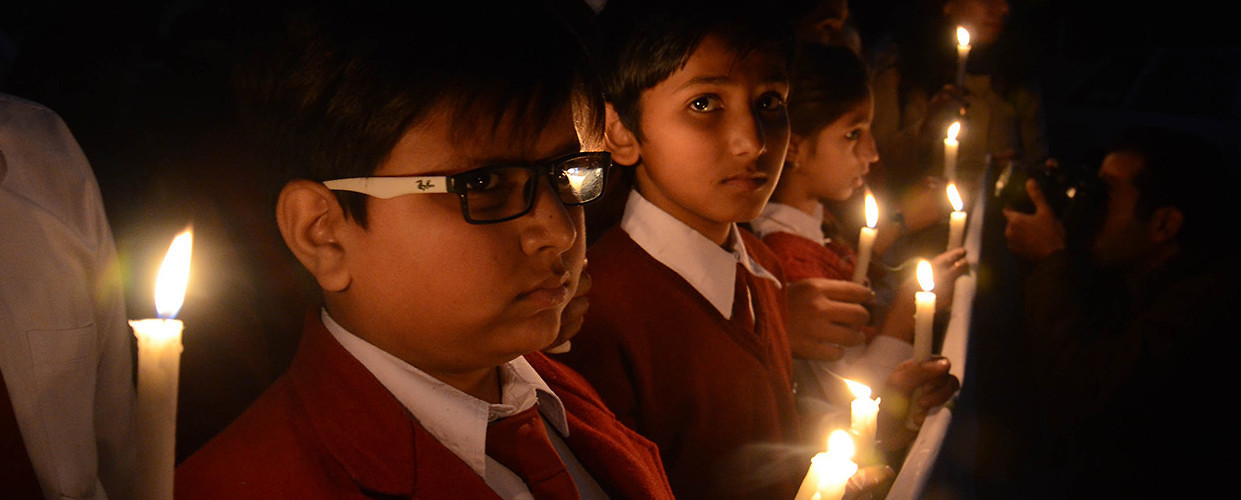 Students light candles for a vigil marking the first anniversary of the Peshawar school massacre. Lahore, Pakistan, December 15, 2015. (Rana Sajid Hussain/Pacific Press/ Getty Images)