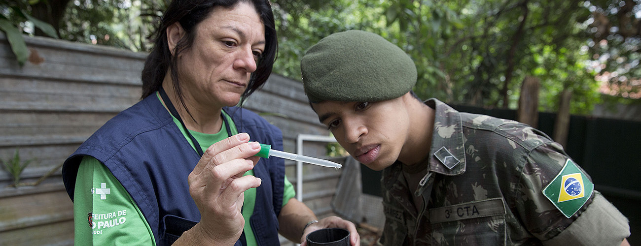 A Brazilian soldier inspects mosquito larvae discovered  during operations targeting the Zika virus. Sao Paulo, Brazil, January 20, 2016.  (AP Photo/Andre Penner)