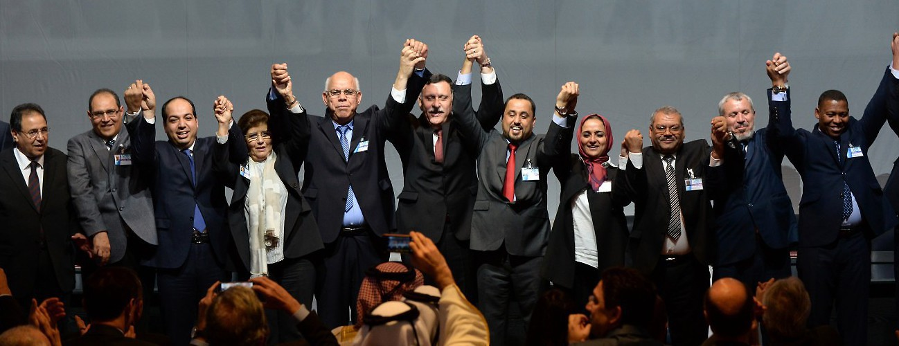 "Rival Libyan politicians celebrate a deal on a unity government despite opposition on both sides, in what the United Nations at the time described as a ""first step"" towards ending the crisis. December 17, 2015, Skhirat, Morocco. (Fadel Senna/AFP/Getty Images)"