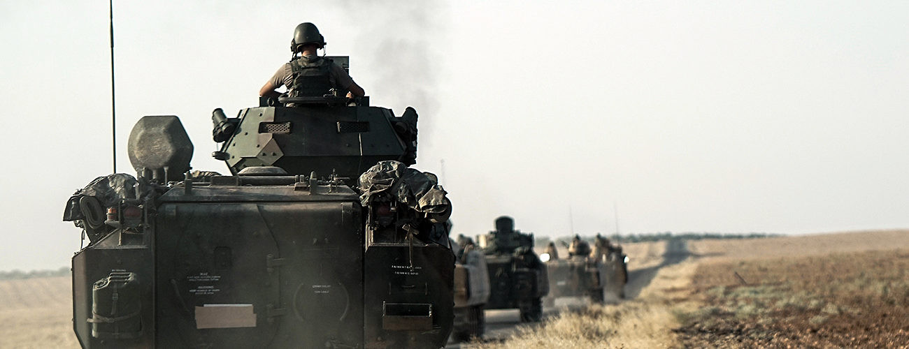 Turkish troops head to the Syrian border to help rebels in the country fight ISIS and to contain Kurdish expansion. Karkamis, Turkey, August 27, 2016. (Halit Onur Sandal/Associated Press)
