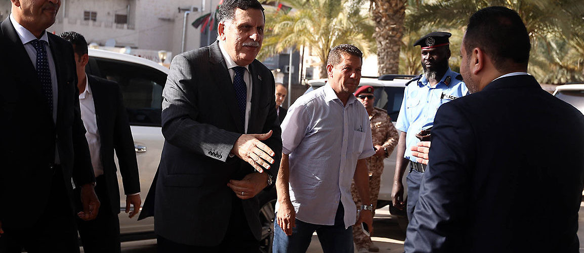 Libya's UN-backed Prime Minister Fayez al-Sarraj arrives at a meeting of his Government of National Accord. Tripoli, Libya, July 11, 2016. (Mahmud Turkia/AFP/Getty Images)