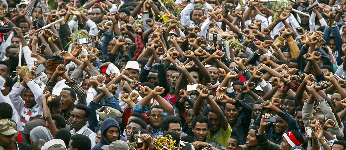 Image result for oromo peaceful demonstration with crossed hands